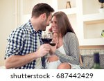 couple drinking a glass of red... | Shutterstock . vector #687442429