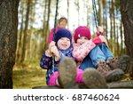 two cute little sisters having... | Shutterstock . vector #687460624