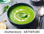 spinach soup with cream in a... | Shutterstock . vector #687469180