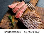 sliced grilled medium rare beef ... | Shutterstock . vector #687501469