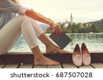 pretty woman enjoying on the...   Shutterstock . vector #687507028