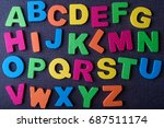 alphabet on a black background.... | Shutterstock . vector #687511174