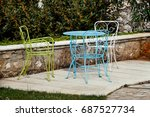 Chairs And A Table In Garden....