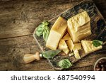 parmesan cheese on wooden board ... | Shutterstock . vector #687540994