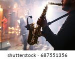 man plays on a saxophone | Shutterstock . vector #687551356