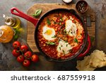 shakshuka with chickpeas in a... | Shutterstock . vector #687559918