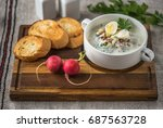 cold soup and bread on a wooden ... | Shutterstock . vector #687563728