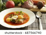 white plate with red borsch on... | Shutterstock . vector #687566740