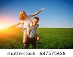 smiling man is holding on his... | Shutterstock . vector #687575638