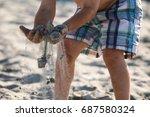a little boy is sifting sand...   Shutterstock . vector #687580324