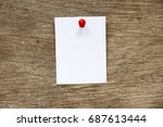 white paper pin on brown wood... | Shutterstock . vector #687613444