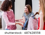 shy smiling girl holding a pack ... | Shutterstock . vector #687628558