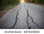 Focused On Cracked Asphalt Road.