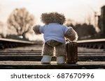 teddy bear carrying his... | Shutterstock . vector #687670996