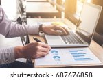 elegant businessman working on... | Shutterstock . vector #687676858