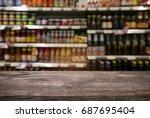 empty wooden table in front of... | Shutterstock . vector #687695404