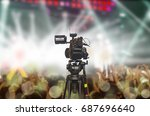 camera filming a concert on... | Shutterstock . vector #687696640