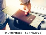 tourists handle passports and... | Shutterstock . vector #687703996