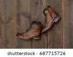 Men\'s Boots Shoes On A Wooden...