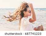 a young woman in sunglasses... | Shutterstock . vector #687741223