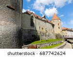 Small photo of Yverdon-les-Bains, Switzerland - 18 April 2017: Castle and its walls. Clock placed in the roof can be seen