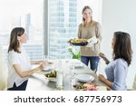 young women having dinner with...   Shutterstock . vector #687756973
