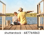 dad and son fishing from pier... | Shutterstock . vector #687764863