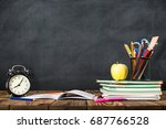 Desk Of Student, Alarm Clock, Books and Pencils - stock photo