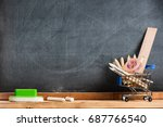 Desk Of Student, Pencils In Metal Shopping Holder On Blackboard Background - stock photo