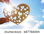 wooden heart shape in hand on... | Shutterstock . vector #687786004
