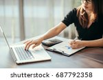 business woman working at... | Shutterstock . vector #687792358