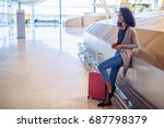 woman waiting her flight using... | Shutterstock . vector #687798379