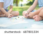 kids playing marbles game... | Shutterstock . vector #687801334