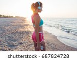 young sportive woman walking... | Shutterstock . vector #687824728