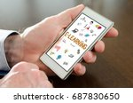 hand holding a smartphone with... | Shutterstock . vector #687830650