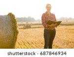 a farmer in a wheat field | Shutterstock . vector #687846934