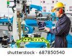 engineer using laptop computer... | Shutterstock . vector #687850540