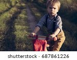 little boy riding a bike on the ... | Shutterstock . vector #687861226