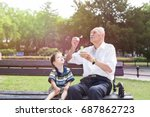 grandfather blowing soap... | Shutterstock . vector #687862723