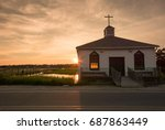 small chapel on the water with...