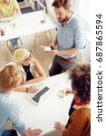 team having a meeting and... | Shutterstock . vector #687865594