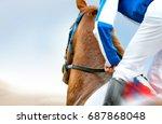 Stock photo jockey on a racehorse closeup 687868048