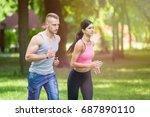 sport woman and man running... | Shutterstock . vector #687890110