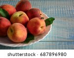 peaches on a plate.summer fruit.... | Shutterstock . vector #687896980