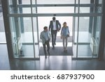 business team gets to work.... | Shutterstock . vector #687937900