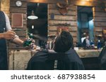 cropped image of barber... | Shutterstock . vector #687938854