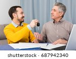 man and young manager sign... | Shutterstock . vector #687942340