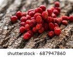 wild strawberries on wooden...   Shutterstock . vector #687947860
