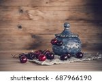 cherries on a table with wooden ... | Shutterstock . vector #687966190