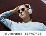 young girl listening to the... | Shutterstock . vector #687967438